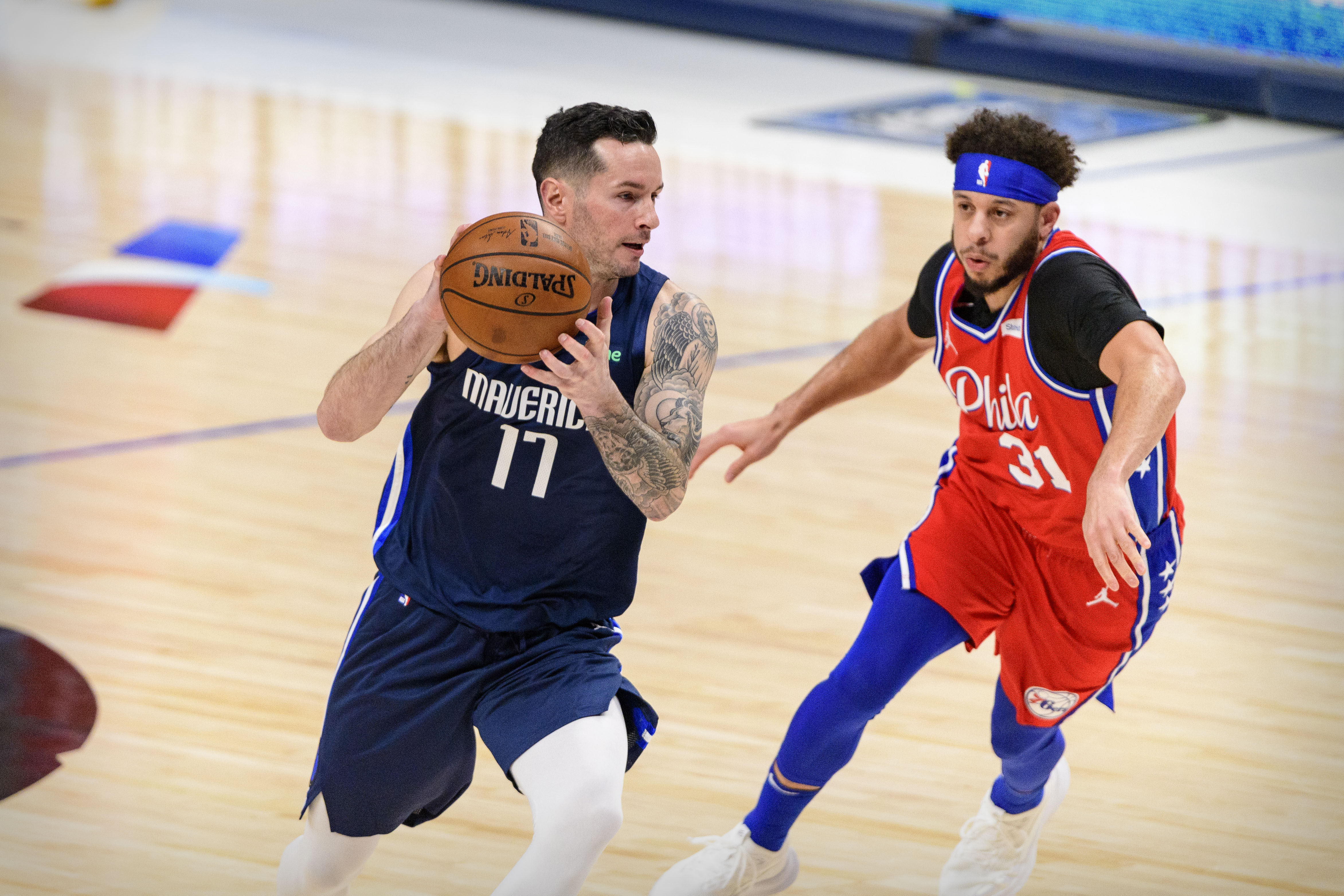 Apr 12, 2021; Dallas, Texas, USA; Dallas Mavericks guard JJ Redick (17) and Philadelphia 76ers guard Seth Curry (31) in action during the game between the Dallas Mavericks and the Philadelphia 76ers at the American Airlines Center.