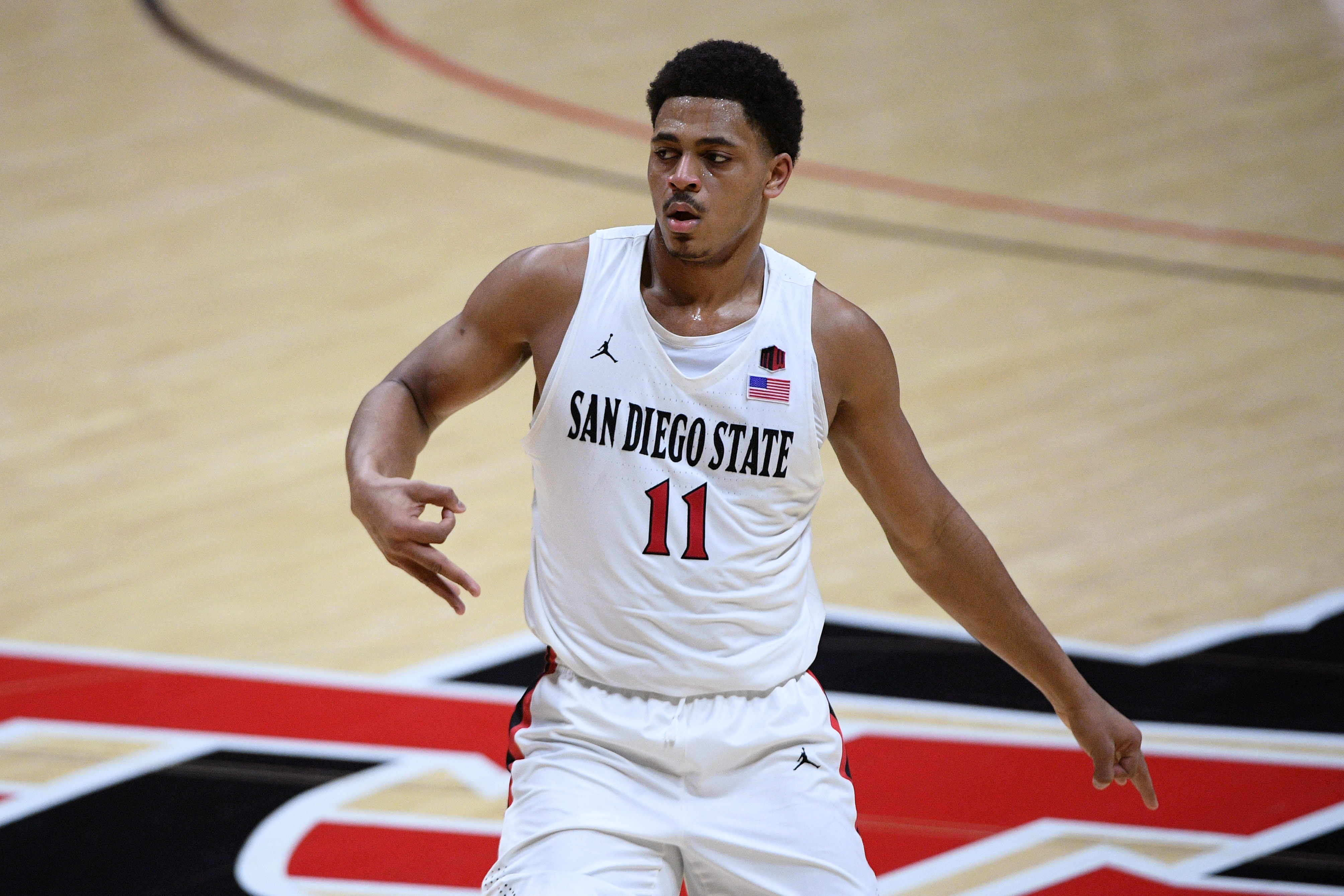Jan 30, 2021; San Diego, California, USA; San Diego State Aztecs forward Matt Mitchell (11) gestures after a three-point basket against the Wyoming Cowboys during the first half at Viejas Arena. Mandatory Credit: