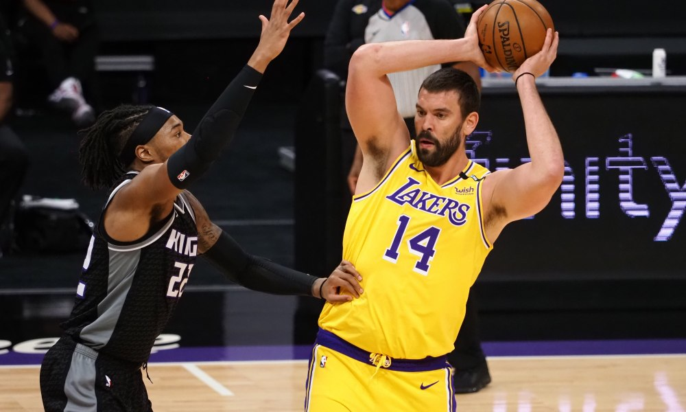 Apr 2, 2021; Sacramento, California, USA; Los Angeles Lakers center Marc Gasol (14) controls the ball against Sacramento Kings forward Richaun Holmes (22) during the first quarter at Golden 1 Center.