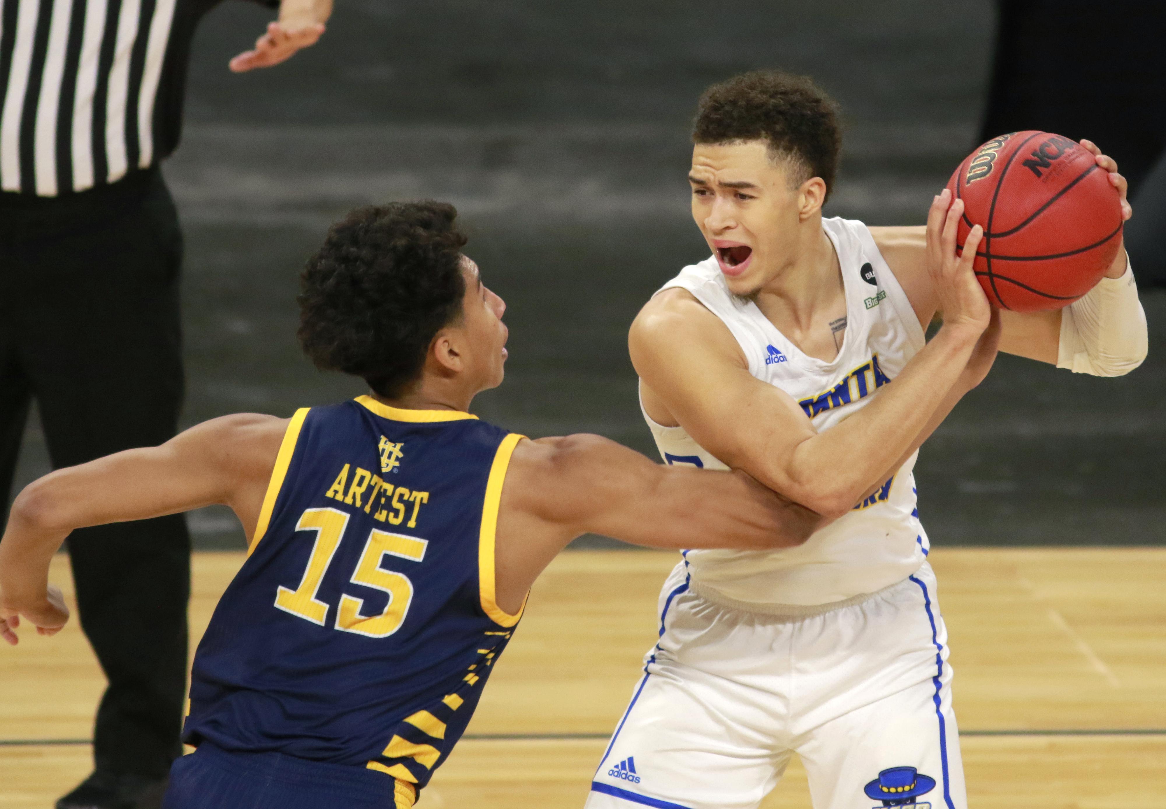 UC Santa Barbara's Jaquori McLaughlin (3) keeps the ball from the reach of UC Irvine's Jeron Artest (15) during the second half of an NCAA college basketball game for the championship of the Big West Conference men's tournament Saturday, March 13, 2021, in Las Vegas. UC Santa Barbara won 79 to 63.
